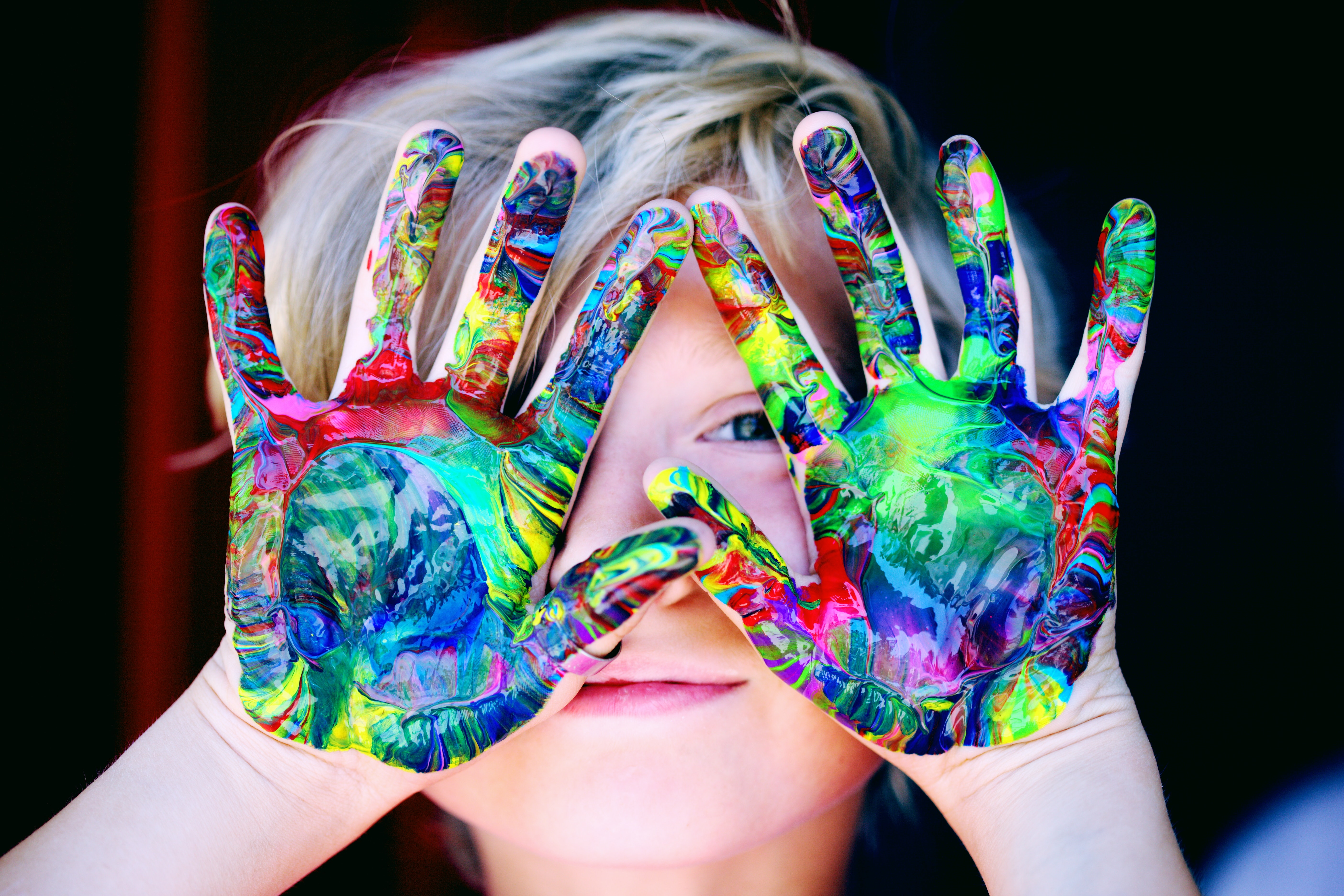 boy with paint on hands
